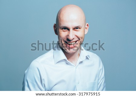 bald young man portrait close-up - stock photo