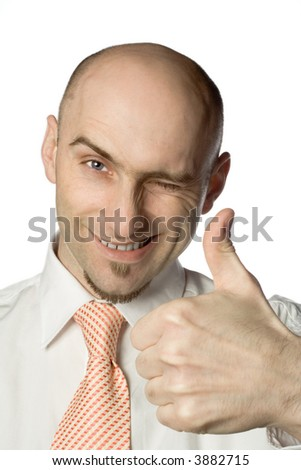 Balding man gives the thumbs up sign while winking - stock photo