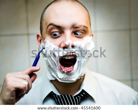 Balding man shaves disposable safety razor