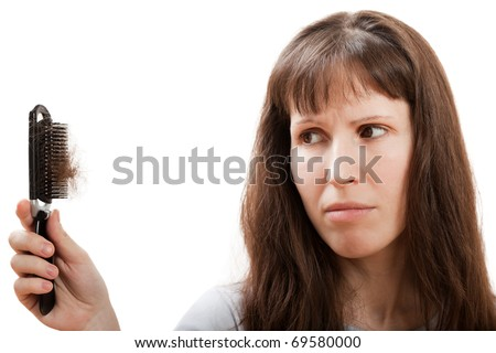Balding problem women hand holding loss hair comb - stock photo