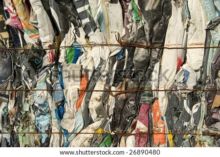 Bale of compressed paper poster for recycling - stock photo