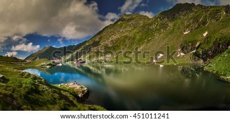BALEA LAKE, ROMANIA Unidentified tourists enjoy the sights of Balea Lake at 2,034 m altitude in Fagaras Mountains, Romania.   - stock photo