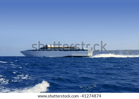 Balearic Islands fast speed Ferry on a sunny blue sky and sea