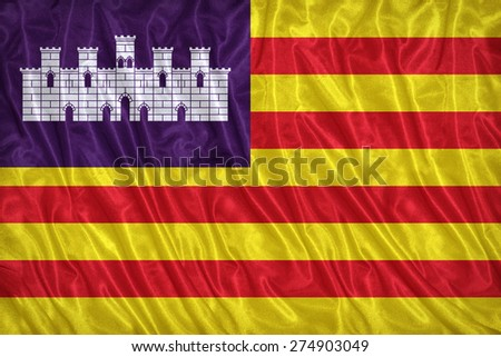 Balearic Islands flag pattern on the fabric texture ,vintage style