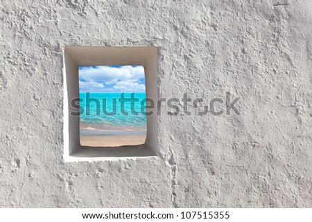 Balearic islands idyllic turquoise beach view through whitewashed house open door [ photo-illustration] - stock photo
