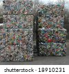 Bales of cans waiting to be recycled at recycling plant - stock photo