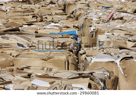 Bales of cardboard slated for recycling. - stock photo