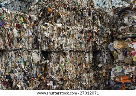Bales of compressed paper for recycling - stock photo