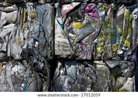 Bales of compressed printing plates for recycling - stock photo