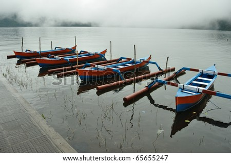 Bali Bratan lake and colorful boats