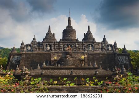 Bali budhist temple Brahma Vihara-Arama Banjar panorama close to Lovina, Indonesia, small version of Borobudur temple on Java - stock photo