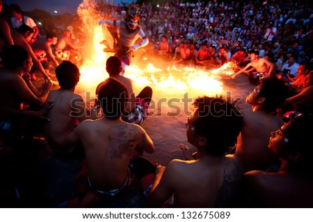 BALI - DECEMBER 30: traditional Balinese Kecak and Fire dance at Uluwatu Temple  on dec 30, 2012, Bali, Indonesia - stock photo