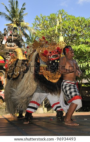 BALI -FEB14: Barong and Kris Dance at Sahadewah,in Batubulan,Gianyar,Bali,Indonesia on February14,2012.This famous Barong Play represents an eternal fight between good and bad spirits - stock photo