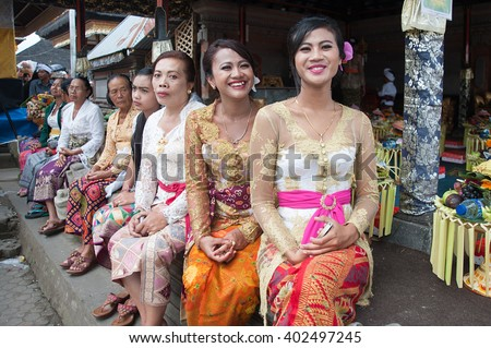 Bali Indonesia Apr 4, 2016 : Balinese lady in traditional costume called Baju Kebaya attending Meprani Ceremony at tample in Batur. Meprani is one of the Hindu ceremony in Bali Island Indonesia. - stock photo