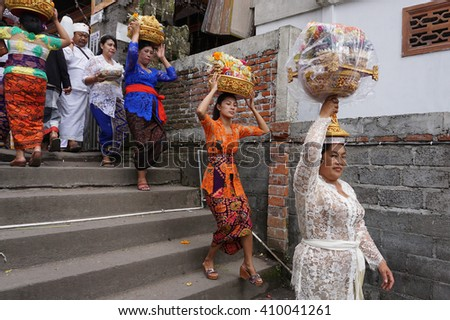 Bali Indonesia Apr 4, 2016 : Balinese woman carrying offering on their head during Meprani Ceremony in Batur. Meprani is one of the Hindu ceremony in Bali Island Indonesia.