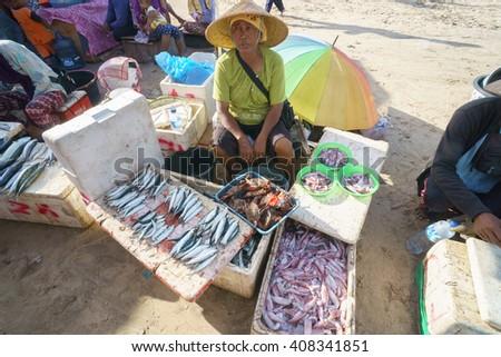 Bali Indonesia Apr 5, 2016 : Balinese woman selling fresh fish at Jimbaran village on Apr 5, 2016 in Bali Indonesia. Jimbaran village is among famous place to see fisherman life in Bali. - stock photo