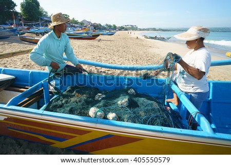 Bali Indonesia - Apr 5, 2016 : Fishermen couple preparing fishing net at Jimbaran village, Bali on Apr 5, 2016 in Bali. Jimbaran village is among famous place to see fisherman life in Bali. - stock photo