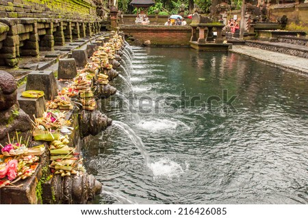 Bali, Indonesia, April 21,2010 : Balinese people at holy spring water at Pura Tirtha Empul  temple during religious ceremony  in Tampak Siring, Bali, Indonesia. - stock photo