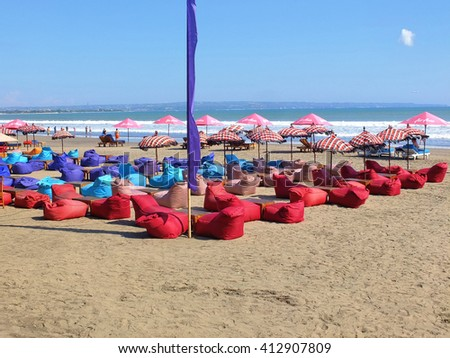 BALI, INDONESIA - APRIL 28, 2016: Beach seating area with bean cushions and umbrellas, Seminyak, Bali, Indonesia.