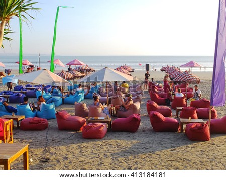 BALI, INDONESIA - APRIL 28, 2016: Beach side cafes with bean bags and umbrellas, Seminyak, Bali, Indonesia.