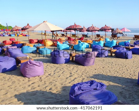 BALI, INDONESIA - APRIL 28, 2016: Bean bags on the beach, Seminyak, Bali, Indonesia.