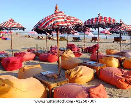 BALI, INDONESIA - APRIL 28, 2016: Bean cushions and umbrellas on beach, Seminyak, Bali, Indonesia.
