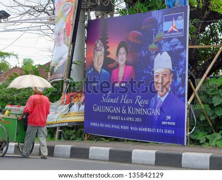 BALI, INDONESIA - April 10: Campaign billboard with President SBY, his wife and politician Jero Wacik on April 10, 2013 in Bali, Indonesia. Campaigning for the 2014 presidential election has begun. - stock photo
