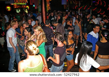 BALI, INDONESIA - APRIL 10: Revellers clubbing in one of the many nightclubs of Kuta, April 10, 2010, Kuta, Bali. Bali now receives over 6 million visitors a year. - stock photo