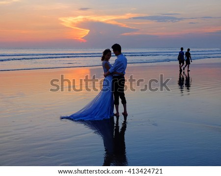 BALI, INDONESIA - APRIL 28, 2016: Wedding couple on the beach at sunset, Bali, Indonesia.