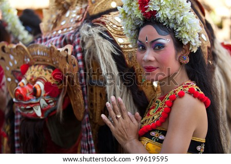 BALI, INDONESIA - APRIL 9: Young girl during a classic national Balinese dance Barong on April 9, 2012 on Bali, Indonesia. Barong is very popular cultural show on Bali.
