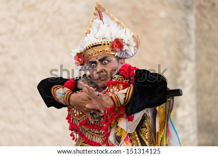 "BALI, INDONESIA - AUGUST 16: Balinese tradition dance ""Legong and barong dance"" is performed at Ganesha Wisnu Kencana (GWK) cultural park, Bali, Indonesia on August 16, 2013."
