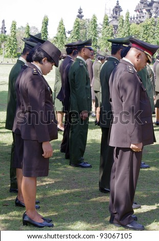 BALI, INDONESIA - AUGUST 17: Soldiers remembering those who died during struggle for Independence on August 17, 2010 in Renon Park, Denpasar, Bali. Independence day is the biggest event of the year. - stock photo