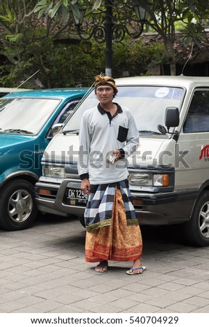 BALI, INDONESIA - CIRCA NOVEMBER 2008: Young valet car in Bali Indonesia