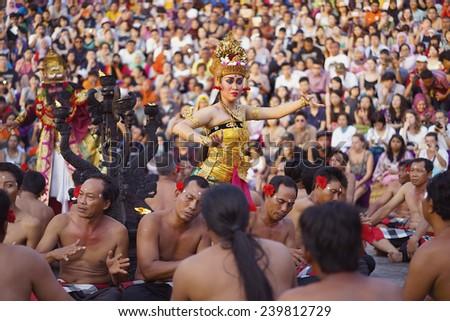Bali, Indonesia - Dec 22, 2014: Kecak - a traditional Balinese dance performed at Uluwatu Temple during sunset, by a dance studio called Sanggar Tari dan Tabuh Karang Boma. - stock photo