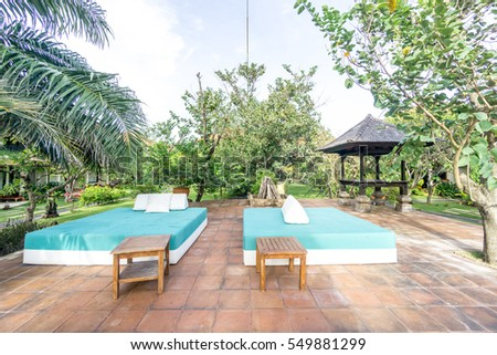 Bali, Indonesia - December 24, 2016:   Hotel outdoor beds of luxury hotel at bali, indonesia