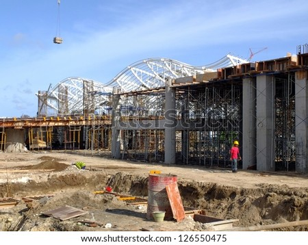 BALI, INDONESIA - JAN 29: Construction of new airport, January 29, 2013, Bali, Indonesia. This $211 million airport will replace the existing airport, increasing capacity to 25 million passengers P/A. - stock photo