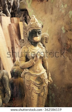 BALI, INDONESIA - January 14, 2016: The stone statue of a Balinese-Hindu goddess waits for a buyer in a stonecarver's workshop on January 14, 2016 in Ubud, Bali, Indonesia.