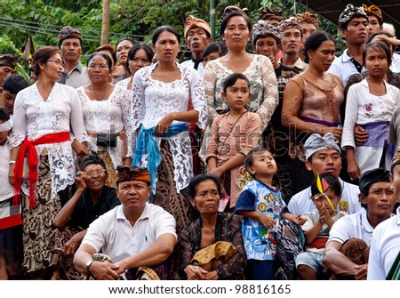 BALI, INDONESIA, JULY 14: unidentified Balinese people participate at the cremation ceremony in Penestanan, Bali on July 14th 2010. - stock photo