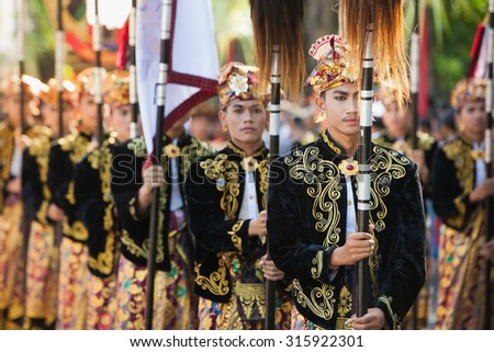 BALI, INDONESIA - JUNE 13: Portrait of Bali males in beautiful Balinese people costumes with traditional style face make-up on parade at  Bali arts and culture festival in Denpasar, Bali 13 June, 2015 - stock photo