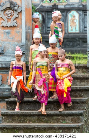 Bali,Indonesia-June 2,2014:Unidentified group of Balinese girl perform for ritual dancing in the temple(pura) - stock photo