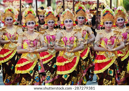 BALI, INDONESIA - JUNE 13: Unidentified people with traditional make-up on their faces and dressed in colorful Balinese costumes on parade at Bali Art Festival 2015 in Denpasar, Bali on 13 June, 2015 - stock photo