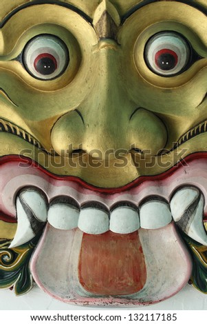 BALI, INDONESIA - MARCH 11: Balinese statue Ogoh-Ogoh ready for Ngrupuk parad on March 11, 2013 in Pemuteran; Bali. Statues Ogoh-Ogoh made for vanquish  negative spirits during  Balinese New Year - stock photo