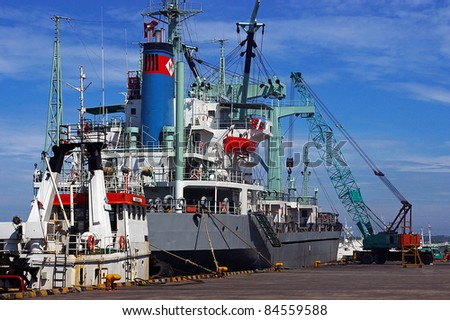 BALI, INDONESIA - MARCH 24: Container ship docked in the port of Benoa on March 24, 2009 in Bali, Indonesia. Indonesia's statistics bureau expects total exports to reach a record $200 billion in 2011.