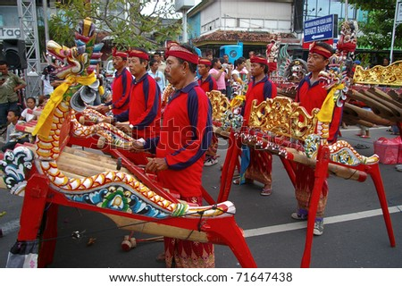 BALI, INDONESIA - MARCH 7: Gamelan players participate in the annual Balinese festival of Pengrupukan, March 7, 2008, Denpasar, Bali. This celebrates the Balinese New Year and the arrival of spring. - stock photo