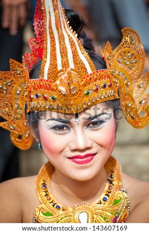 BALI, INDONESIA - MARCH 16: Girl during a classic national Balinese dance Barong on March 16, 2013 on Bali, Indonesia. Barong is very popular cultural show on Bali. - stock photo