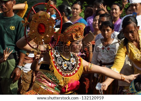 BALI, INDONESIA - MARCH 11:   Hindu Ngrupuk parade on March 11, 2013 in Pemuteran, Bali. Hindu Ngrupuk rituals is performed in order to vanquish the negative spirits - stock photo