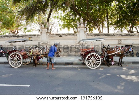 BALI, INDONESIA - MARCH 15: Horse cart service in Kuta, Bali on March 15, 2014. Alternative public transport to explore Kuta town