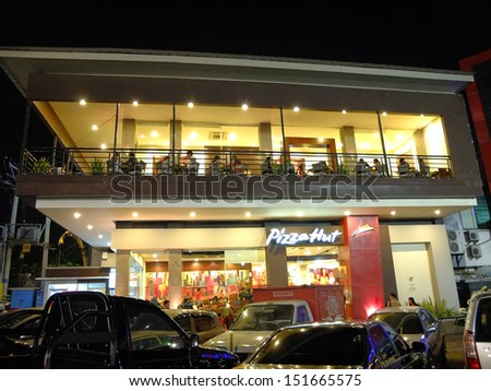 BALI, INDONESIA - MARCH 31: Pizza Hut restaurant on March 31, 2013 in Bali, Indonesia. This American restaurant has increased its store locations outside of the United States to 5139 branches. - stock photo