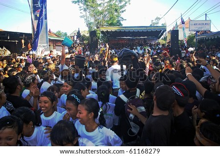 BALI, INDONESIA - MARCH 27: Unique Balinese festival of Omed Omedan, March 27, 2009, Denpasar, Bali. Unmarried girls and boys are required to publicly kiss as part of Balinese New Year celebrations.