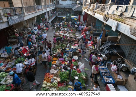 BALI, INDONESIA - MARCH 16, 2016: View of the commercial and trading activities in the morning on the ground floor of the main market in Ubud town on Bali Island.  - stock photo